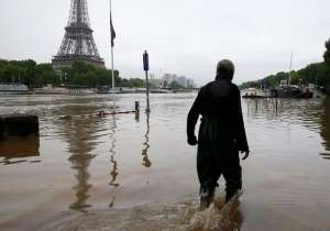 Paris Flood water was flowing through the streets of Paris on Friday as water level in Seine River reached 19 ft above normal, officials said. Across the city, museums, parks and cemeteries were being closed as the city braced for possible evacuations. In Paris, emergency barriers have been put up along the Seine, which burst its banks in places. Rail operator SNCF has closed a line that runs alongside the Seine in central Paris. About 25,000 people are without power in Paris and central France. In Nemours, 3,000 people have been evacuated from the town centre. The town's Loing river, a tributary of the Seine, now has levels not seen since the devastating floods of 1910. Six weeks' worth of rain has fallen in three days in the Loiret department, submerging roads and forcing drivers to abandon their cars. President Francois Hollande is set to declare a state of natural disaster in the worst-hit areas. Let us understand how the flood has affected the people of Paris- India Tv