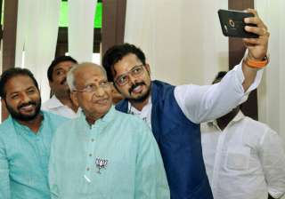 BJP's Thiruvananthapuram central candidate S Sreesanth takes a selfie with the party's winning candidate O Rajagopal at the party headquarters in Thiruvananthapuram on Thursday.