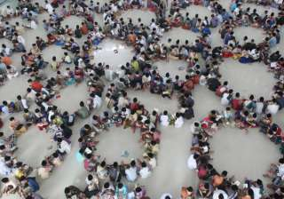 Students sit in circles during a Quran recital class on the first day of the holy fasting month of Ramadan at Ar-Raudlatul Hasanah Islamic boarding school in Medan, North Sumatra, Indonesia.