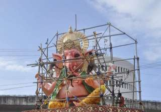 Artisians busy giving finishing touches to a 28 feet tall idol of Lord Ganesha on the eve of Ganesh Chaturthi at Athgaon in Guwahati.