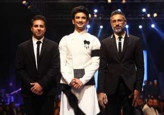 Sushant Singh Rajput is all smiles as he posed with designers Shantanu and Nikhil post his ramp walk.