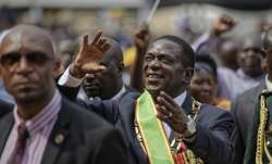 Zimbabwe's President Emmerson Mnangagwa gestures to the