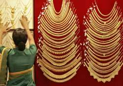 gold jumps on heavy stockists buying seasonal demand weighs
