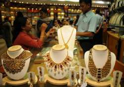 gold slips on subdued demand global cues silver edges up