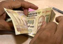 rupee gains 7 paise against dollar in early trade
