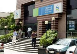 standard chartered bank sees marginal breach in fy 14