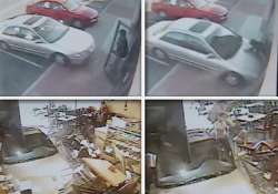 cctv footage of car crashing in restaurant
