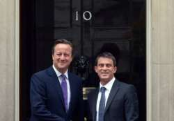 british french pms discuss economy is threat