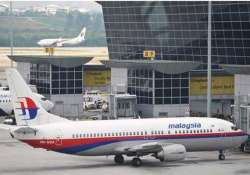 malaysian jet washed up metal piece sparks speculations