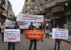 syrian forces kill 13 civilians in homs activists