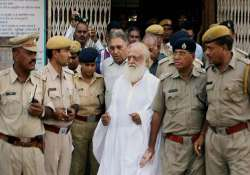 asaram bapu sent to 14 days in jail supporters create