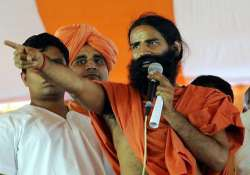 congress is a sinking ship says swami ramdev