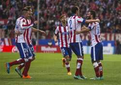 atletico madrid beats deportivo after violent clash