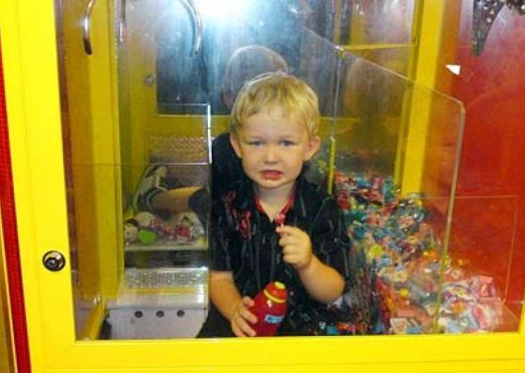 australian toddler trapped inside lolly machine while trying to grab sweets- India Tv