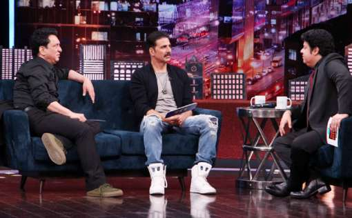 The 'Rustom' actor sharing a word with the two Sajids during the chat show.