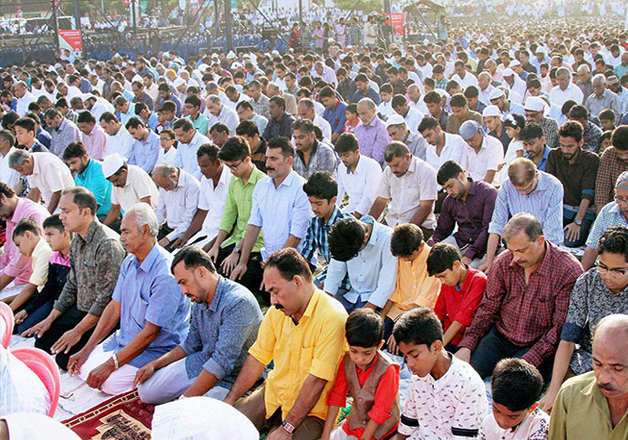 Devotees offer prayers on the day of Eid al-Adha at the beach in Kozhikode, Kerala.