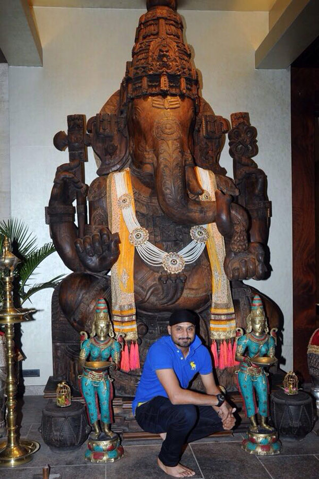 Cricketer Harbhajan Singh poses in front of a huge Ganpati statue as he wishes his fans a happy Ganesh Chaturthi.