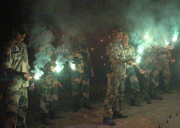 BSF jawans celebrating Diwali near the India-Bangladesh border in South Dinajpur district of West Bengal.