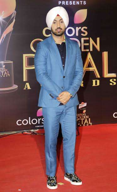 Actor Diljit Dosanjh looked handsome as he wore a blue suit and teamed it well with quirky shoes.