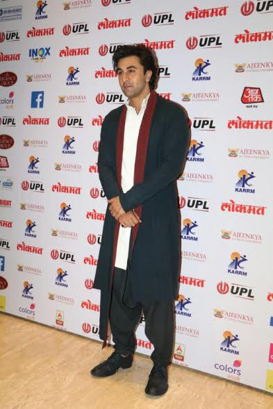 Ranbir Kapoor looked cool in a white and black kurta pyjama paired with a long black jacket.