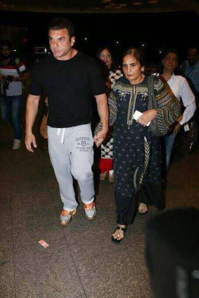 Sohail Khan kept it comfortable in a black tee, grey tracks and sporty shoes. The actor was seen with mother Sushila Charak.