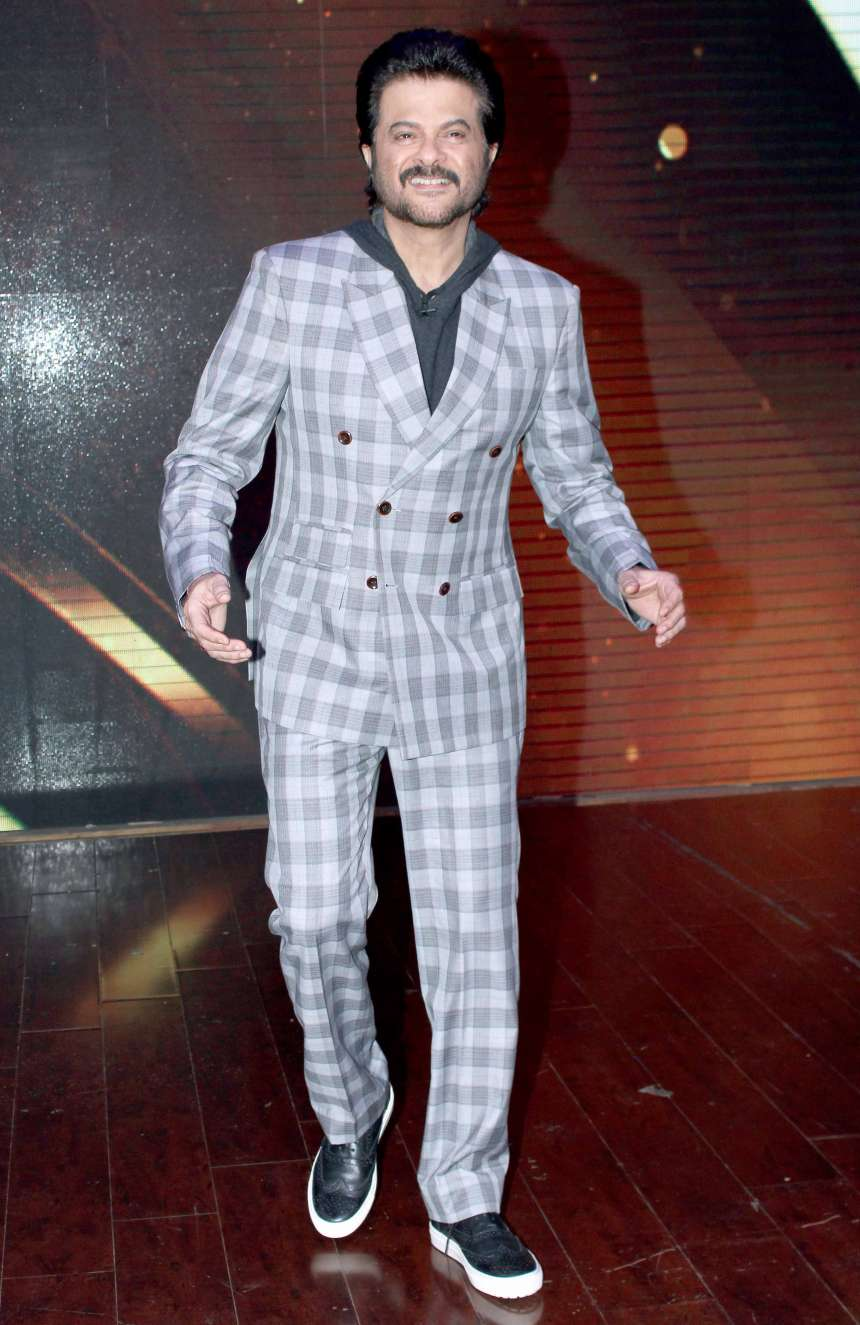 Anil Kapoor spotted as always in his jhakass mood and was experimenting with grey check print suit over a hoodie.