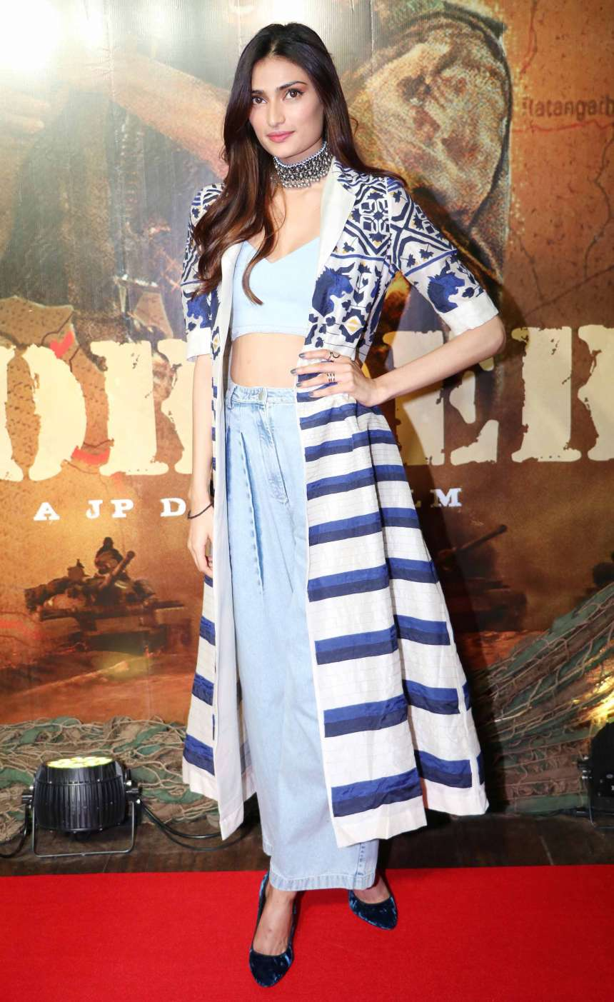Athiya Shetty spotted in the celebration of border movie. She wore a blue denim plazo and paired it with white crop top with a pair of blue velvet heels.