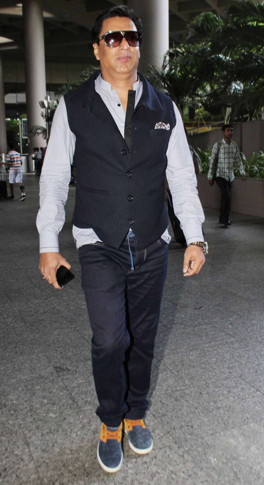 Gulshan Grover: Gulshan Grover wore a light blue shirt, navy blue trousers and a waist coat of the same colour at an airport.