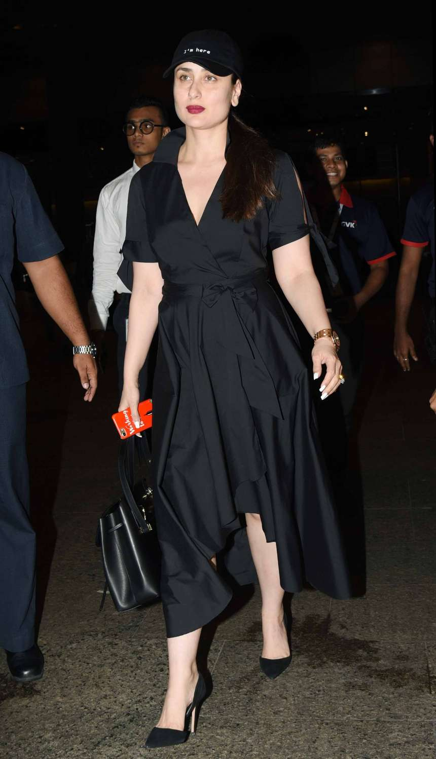 Kareena Kapoor Khan is slaying in a black long dress with a black cap and a berry shade lipstick. She has paired her dress with a pair of black stilettos.