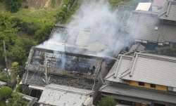 Smoke rises from a house blaze in Takatsuki, Osaka,