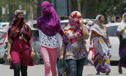 Allahabad: Girls cover their faces to beat the heat on a