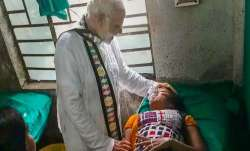 Prime Minister Narendra Modi visits a woman, who was