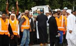 Mourners carry the body of Imam Hafiz Musa Patel, a victim