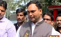 Delhi's Ambedkar Nagar MLA Ajay Dutt tears off his shirt to