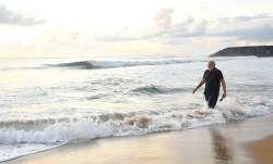 PM Narendra Modi takes refreshing walk at a beach in