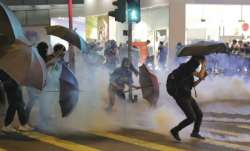 Hong Kong protesters vandalize subway station, storm mall