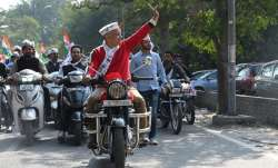 Delhi deputy chief minister Manish Sisodia riding a bike