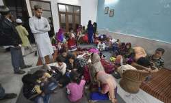 People take refuge at a residence in Chaman Park area of