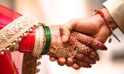 Coronavirus lockdown: UP groom takes bride home on motorcycle