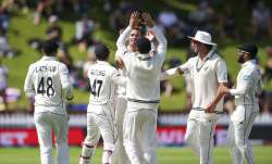 Tim Southee of New Zealand celebrates with teammates after