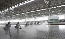 firefighters conduct disinfection on the platform at Yichang East Railway Station in Yichang, in cen