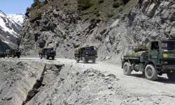 An army convoy moving towards the Zojilla pass, in Drass,