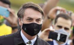 In this May 25, 2020, file photo, Brazil's President Jair Bolsonaro, wearing a face mask amid the co
