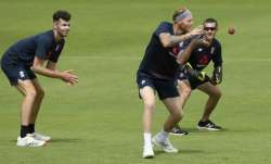 England captain Ben Stokes takes a catch in the slips