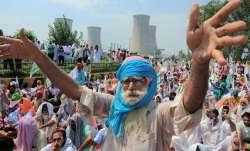 "Farmers outfits in Karnataka protest ""anti-farmer"" policies"