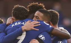 Chelsea players celebrate with Hakim Ziyech, centre right,