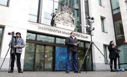 Journalists report the verdict to allow the extradition of