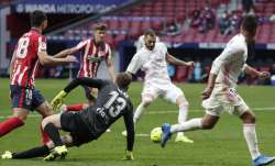 Real Madrid's Karim Benzema scores his side's opening goal