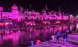 Devotees light earthen lamps at illuminated Ram Ki Paidi to