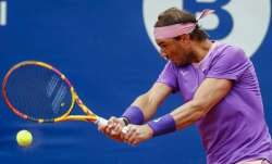 Rafael Nadal of Spain returns the ball to Ilya Ivashka of